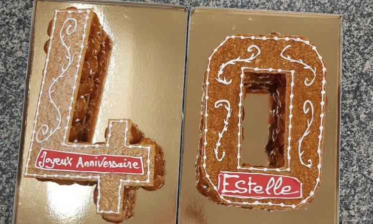 Boulangerie BRESNU - Préparation d'une pièce montée sur mesure pour anniversaire - Chatuzange-le-Goubet